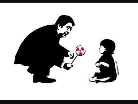 放射能のアメを子供に与える安倍首相(ドイツ紙風刺画)