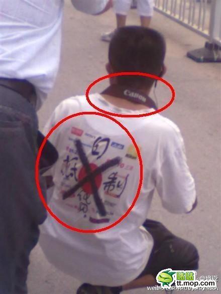 反日デモ 日本製カメラ キャノン